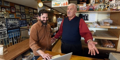 Daniel Rotsztain (left) shows Tony Kiriakou, owner of Wexford Heights Plaza, his vision for enhancing strip plazas by improving landscaping around restaruants and cafes. Rotsztain is one of the creators of plazaPOPS, a project designed to suggest ways strip plazas can spruce themselves up in exciting ways.